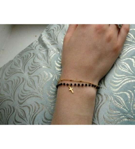 Goudkleurige armband met zwarte steentjes en kruis